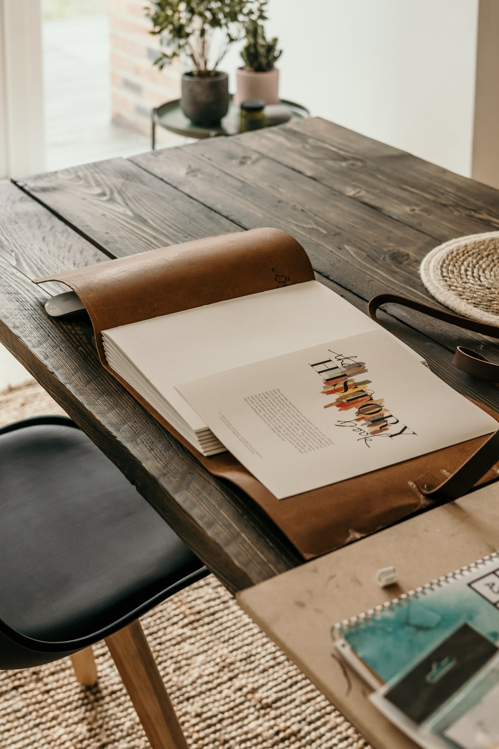white book on black wooden table