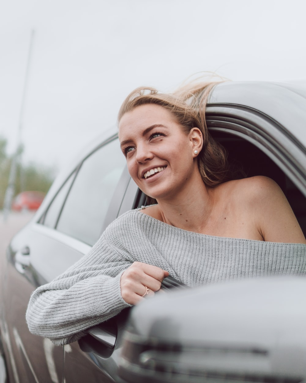 woman in white knit sweater smiling