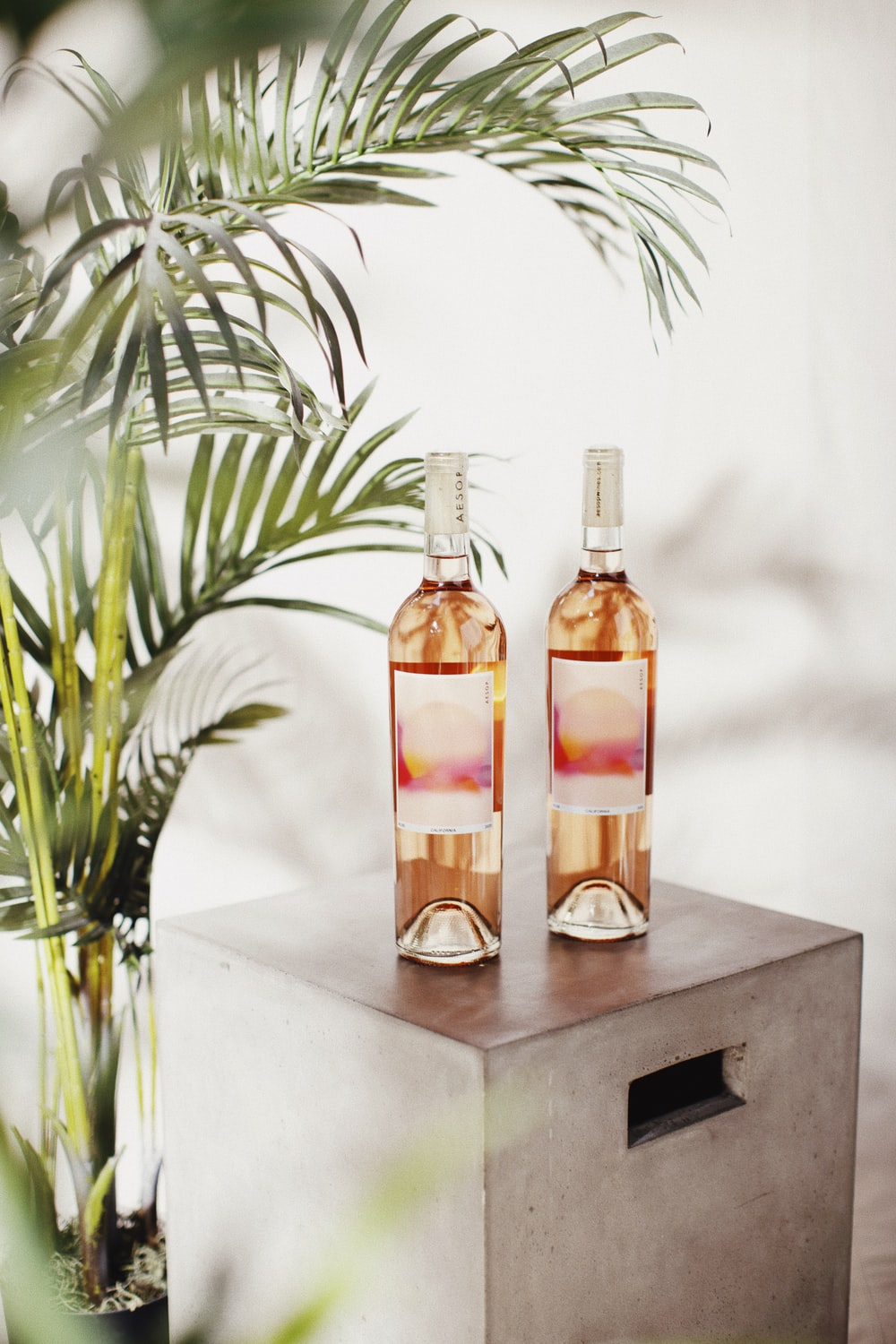 two bottles on black wooden table