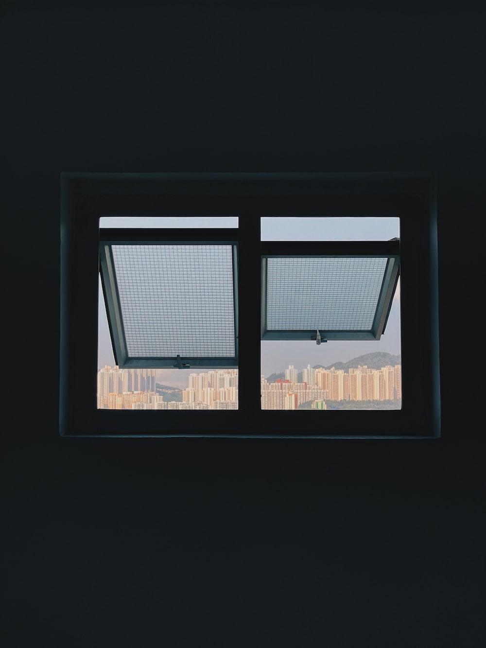 black framed glass window during daytime