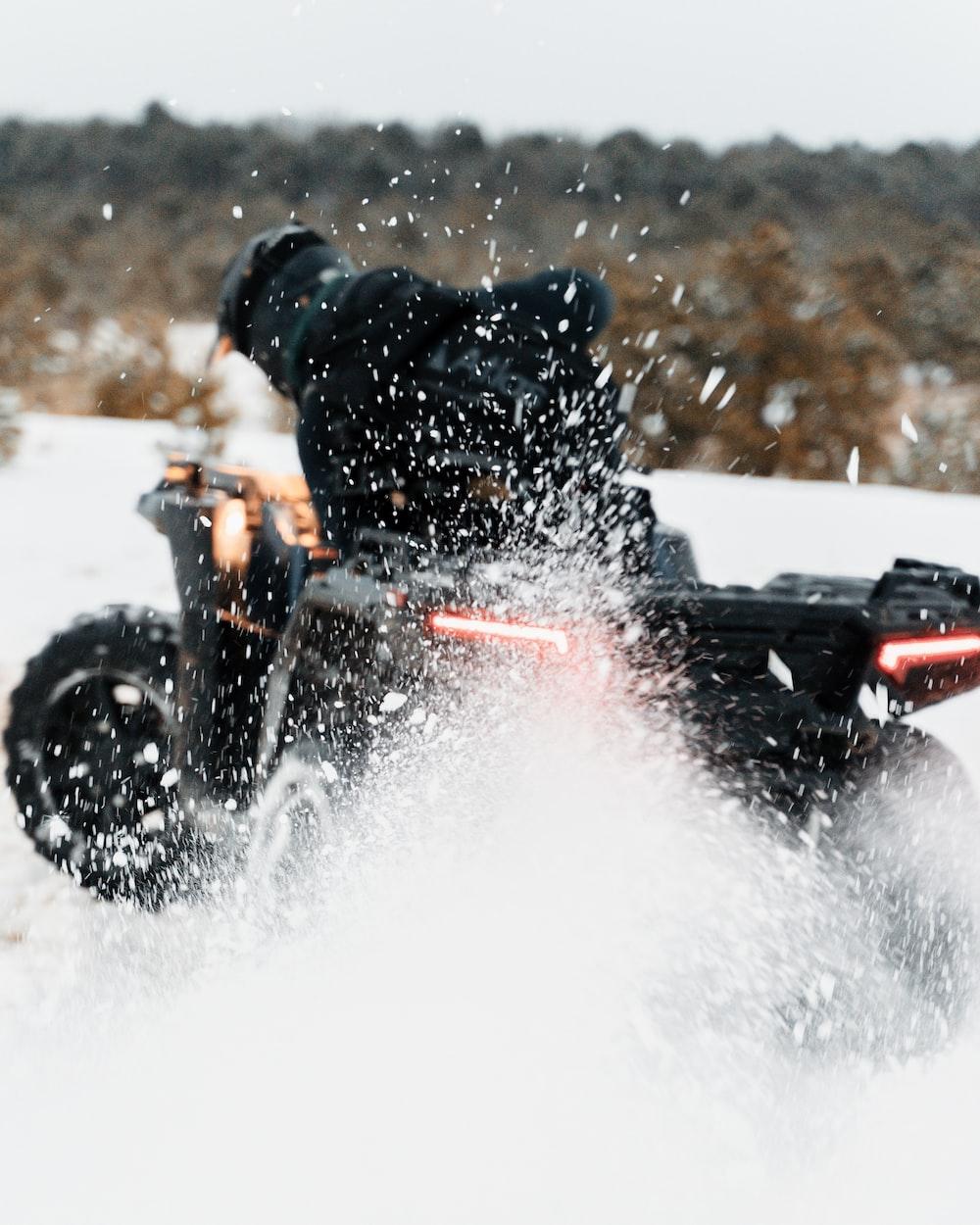 man riding black motorcycle on water