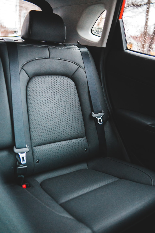 black leather car seat during daytime