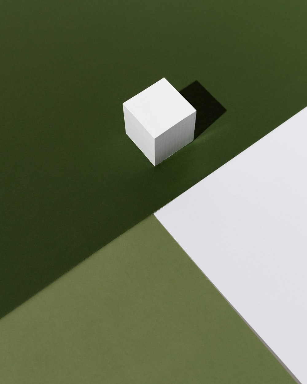 white box on green table