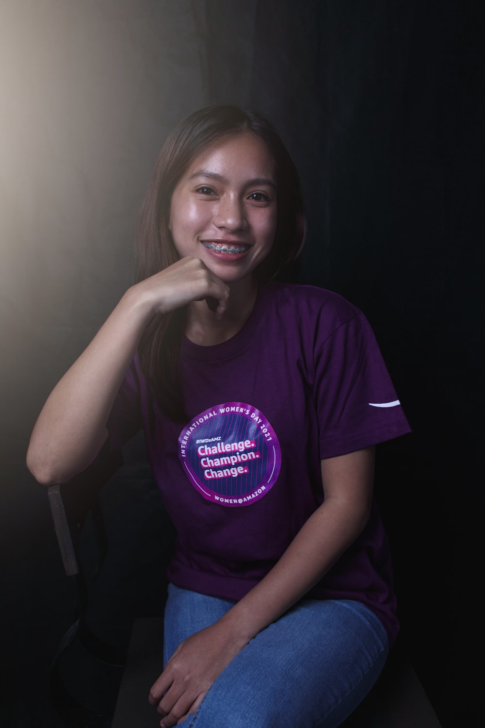 woman in purple crew neck t-shirt smiling
