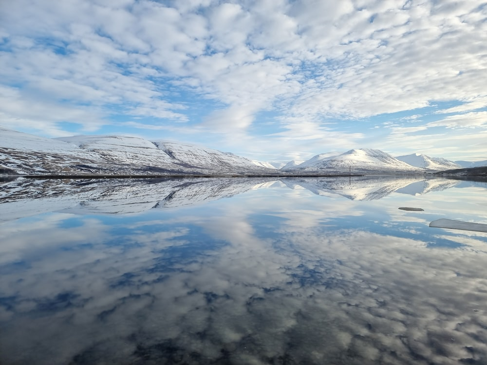 white clouds over calm water