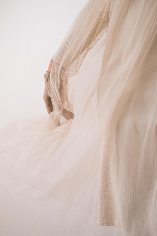 white textile on white background