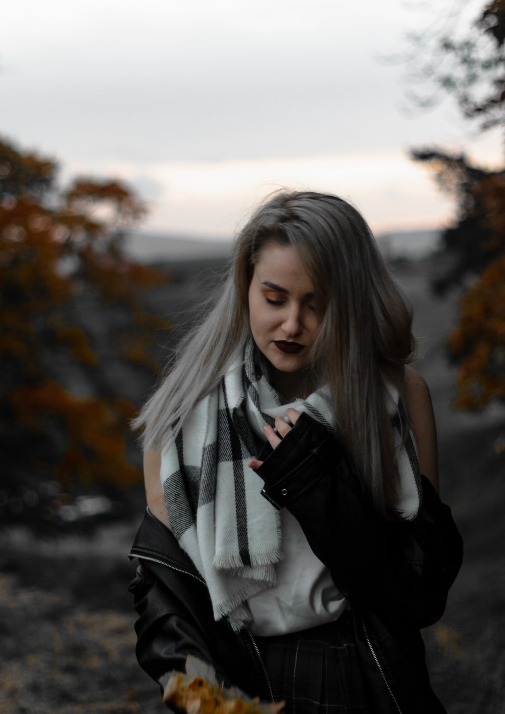 woman in black and white scarf and black leather jacket