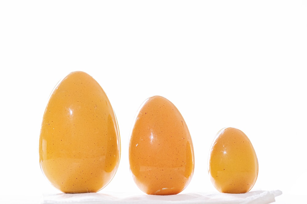 2 yellow egg on white background