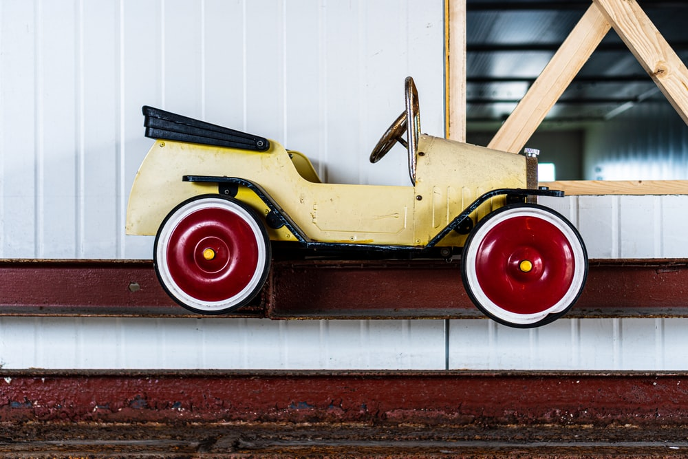 yellow and red vintage car
