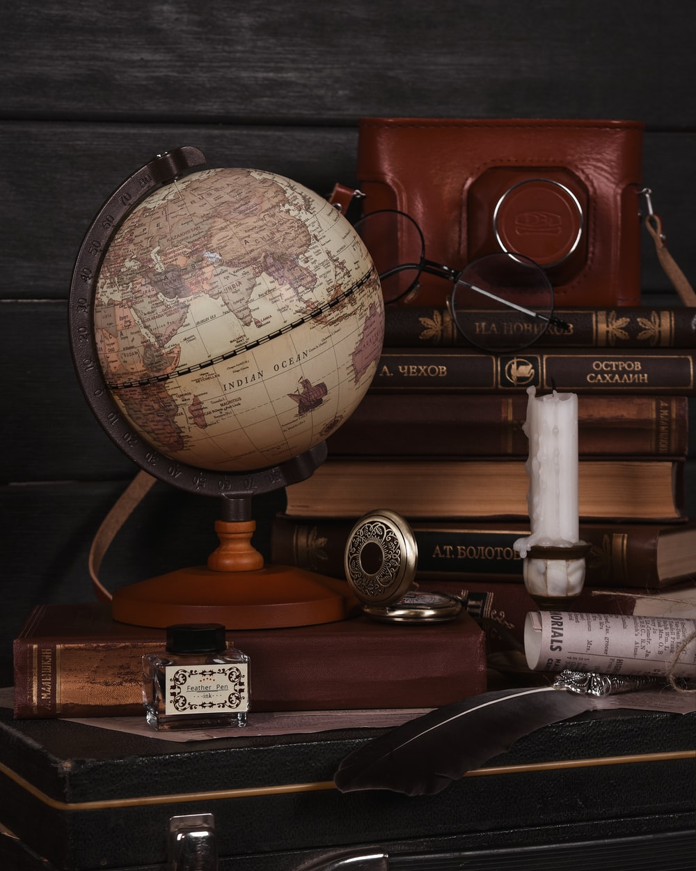 brown and silver desk globe