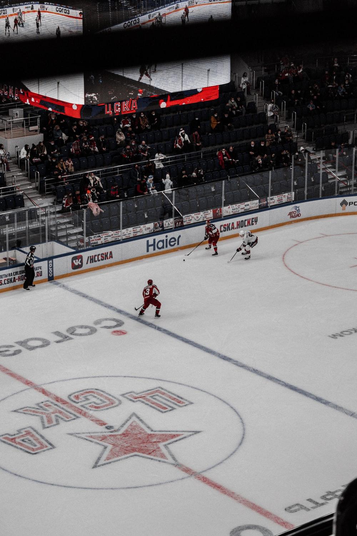 people playing ice hockey on stadium