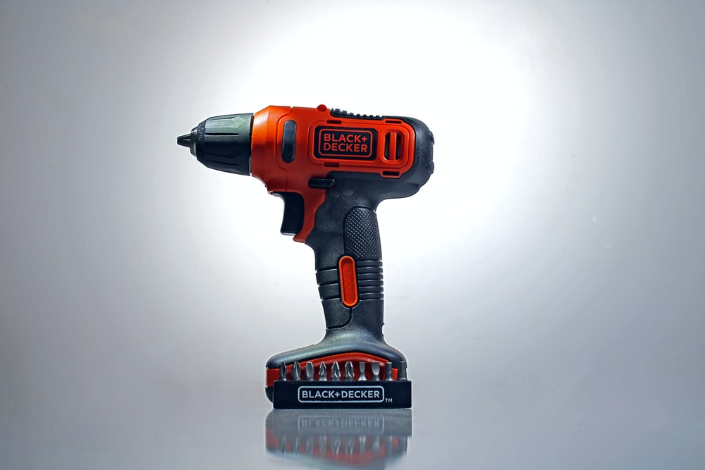 orange and black black decker cordless hand drill