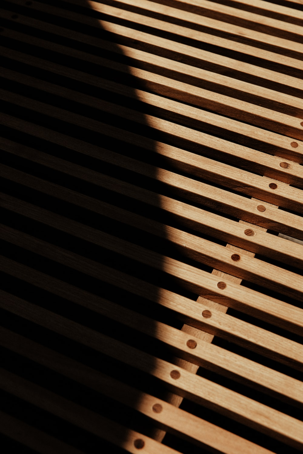 brown wooden fence with light