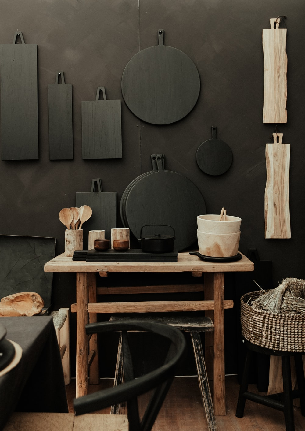 black cooking pot on brown wooden table
