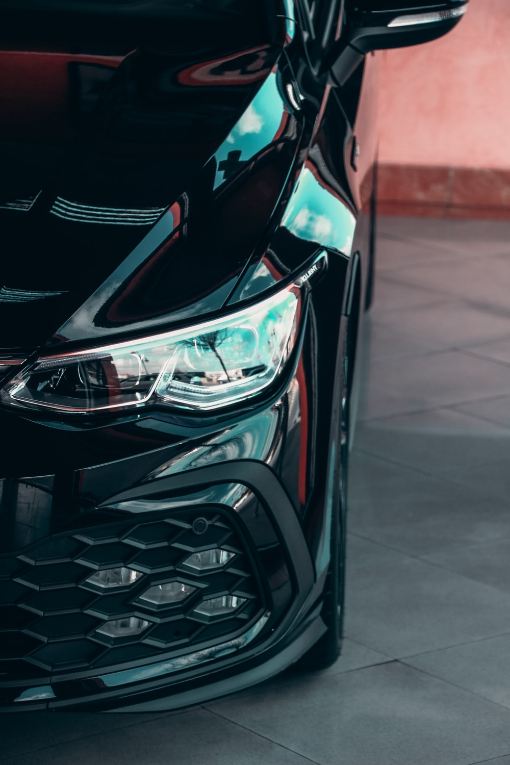 black and red car in close up photography