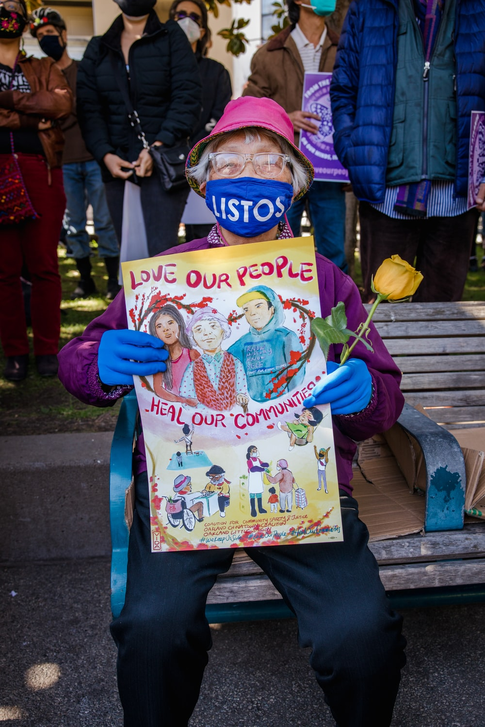 girl in blue jacket holding happy birthday greeting card