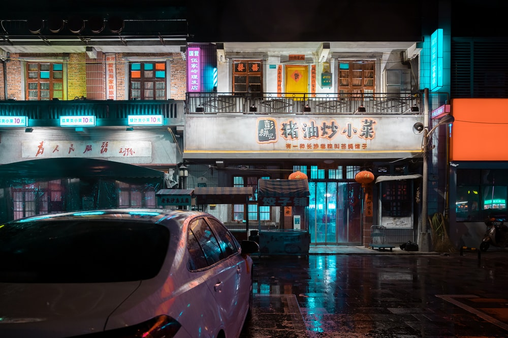 cars parked in front of building during night time