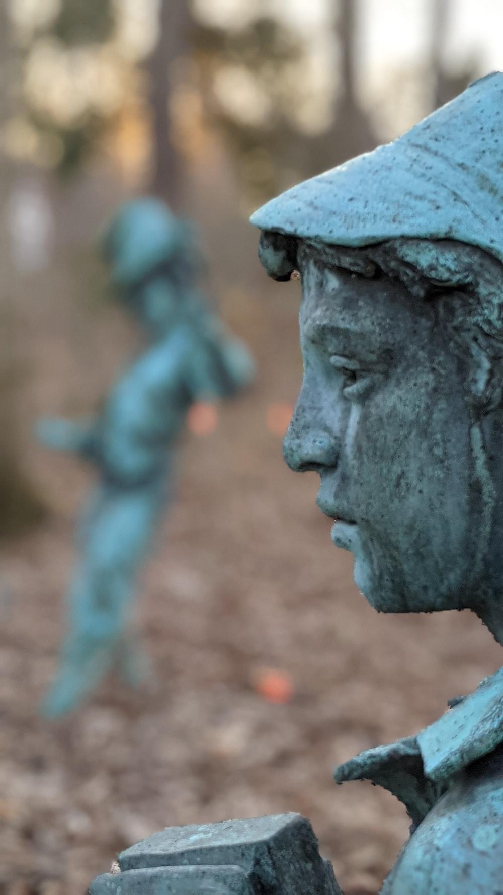 man in blue hat statue