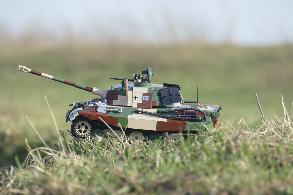 green and brown battle tank scale model