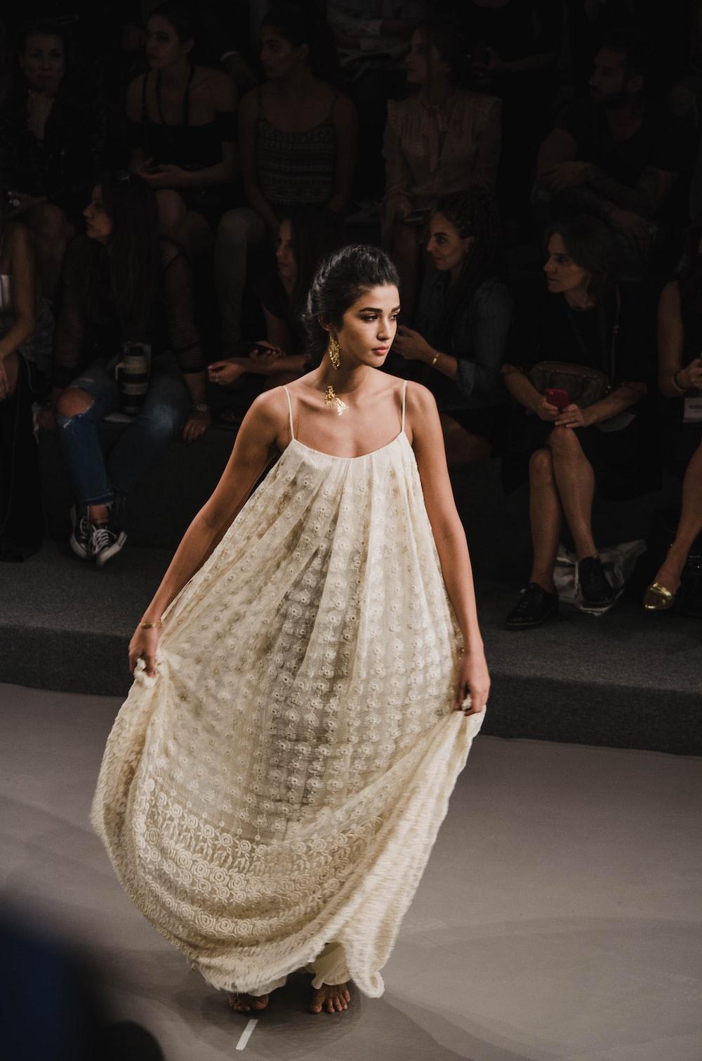 woman in beige tube dress