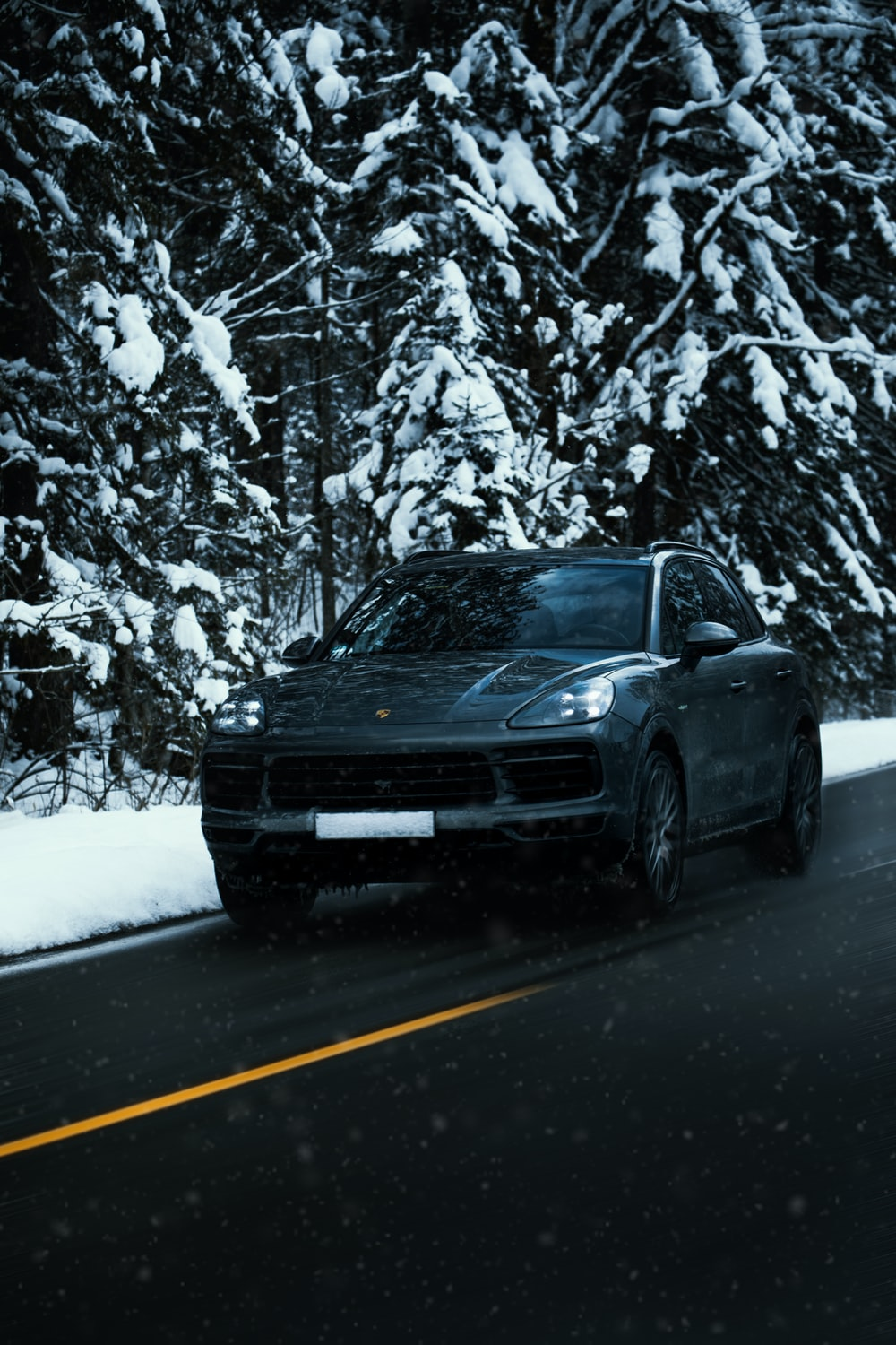 black car on road during winter