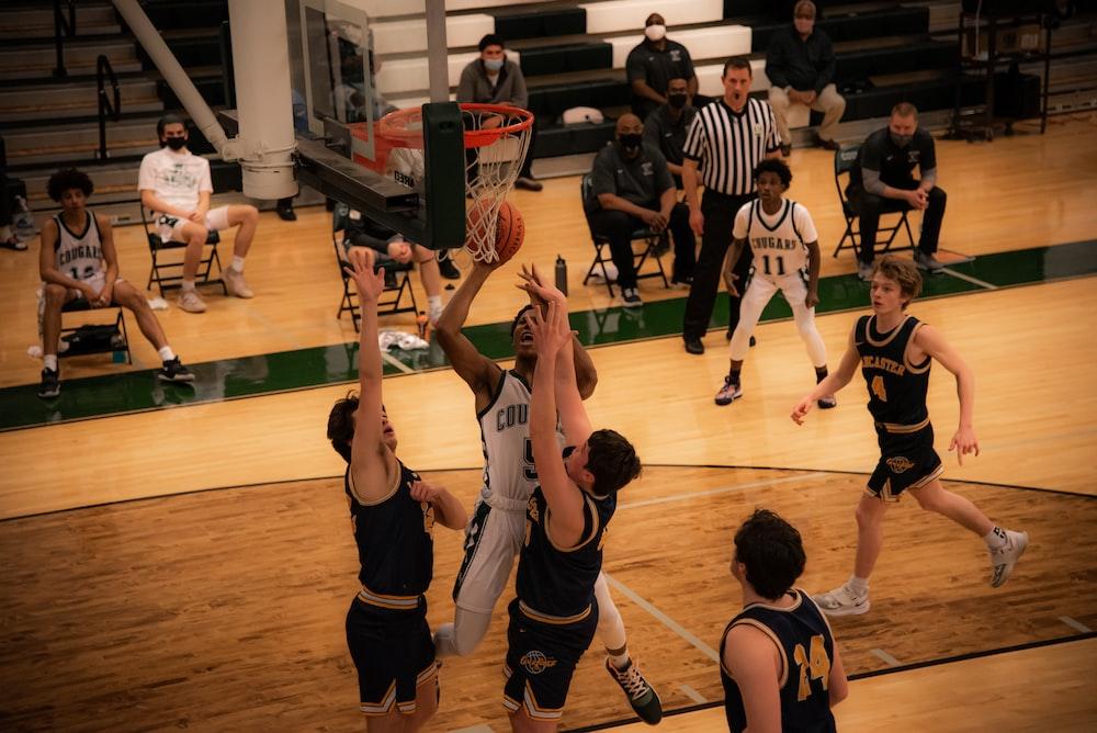 basketball players playing on basketball court