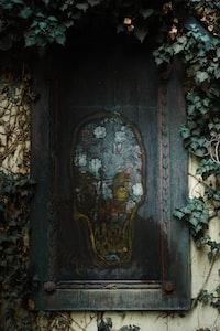 blue wooden door with gold and black door lever