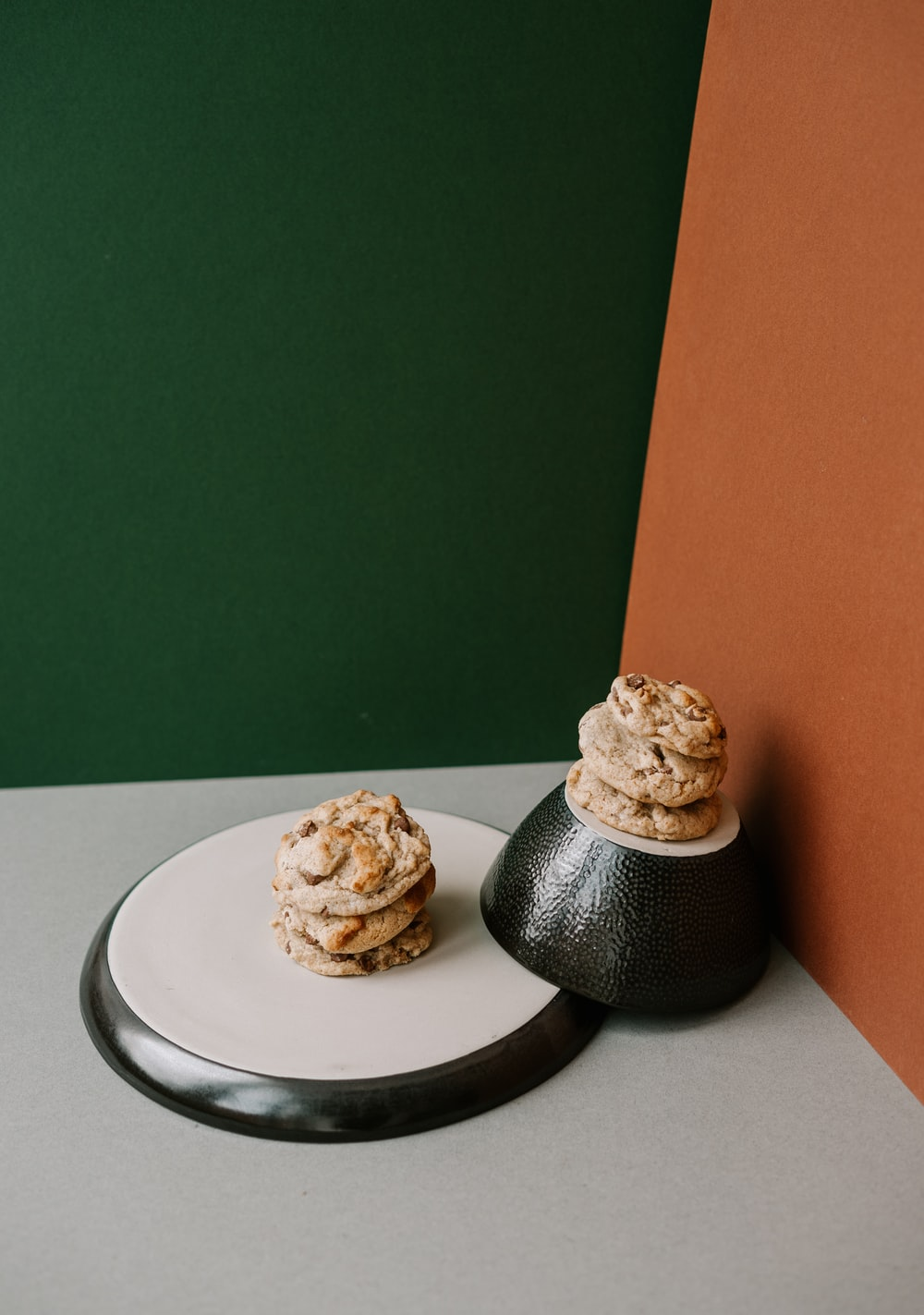 two brown cookies on white ceramic plate