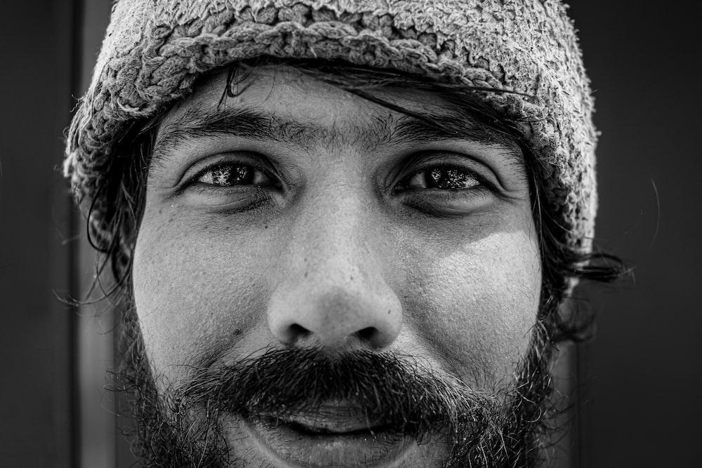 man wearing brown knit cap