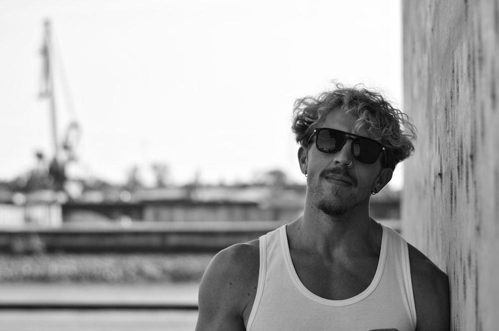 man in white tank top wearing sunglasses