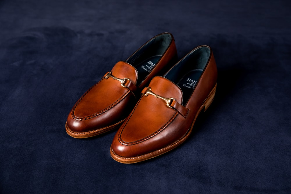 brown leather loafers on blue textile