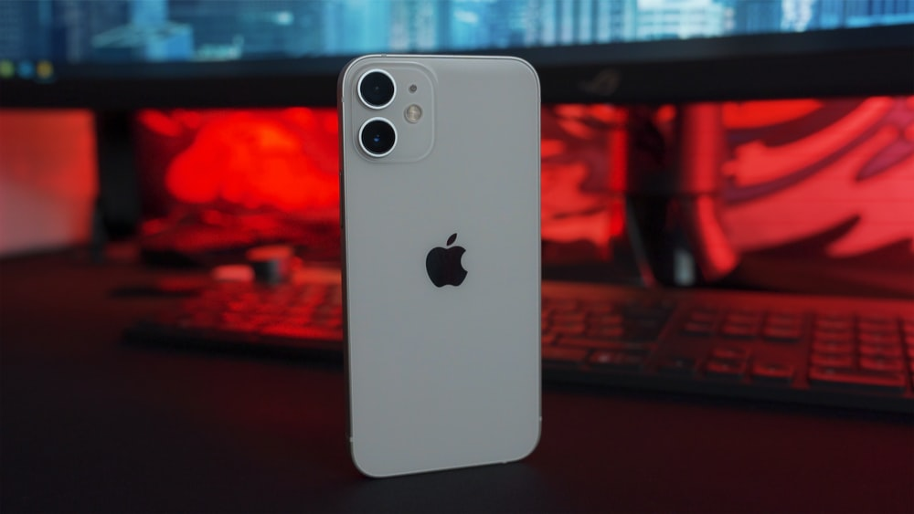 white iphone 5 c on table