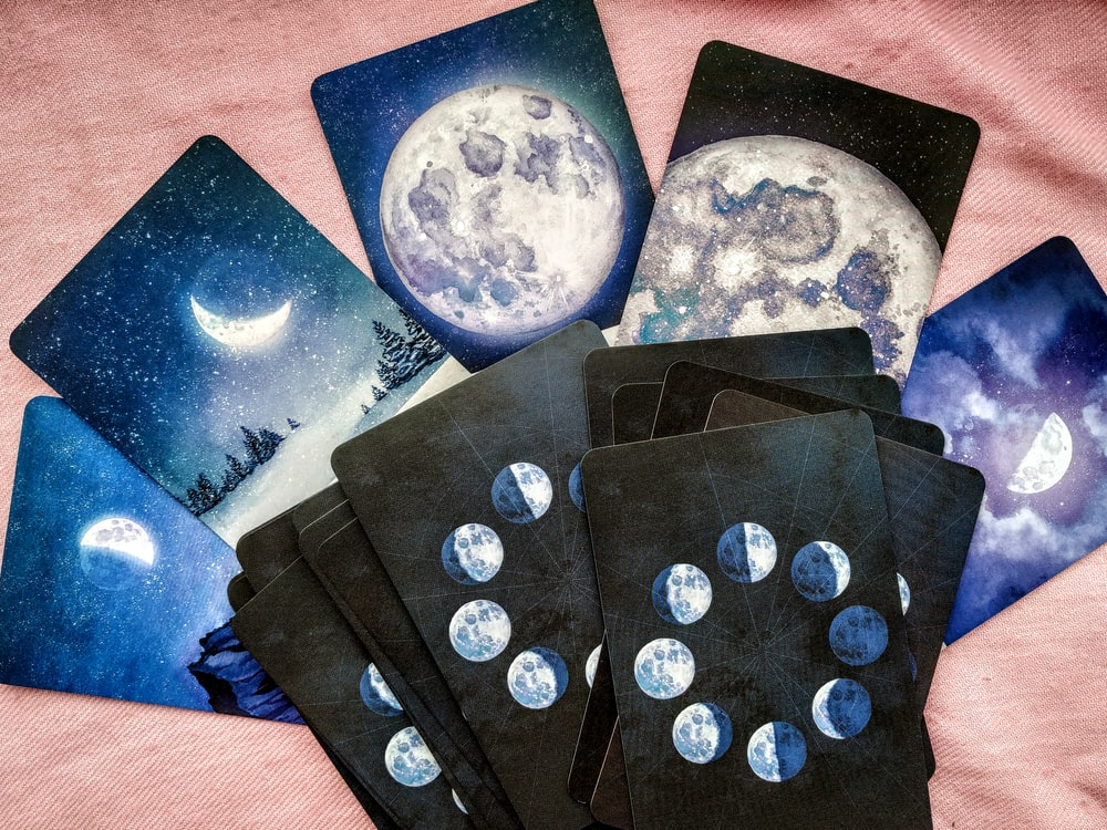 blue and white moon and star print textile