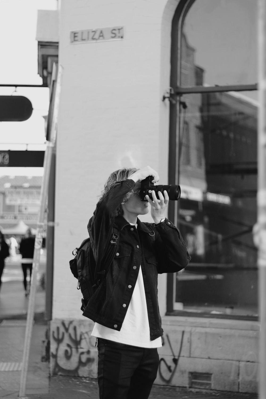 woman in black coat wearing black sunglasses