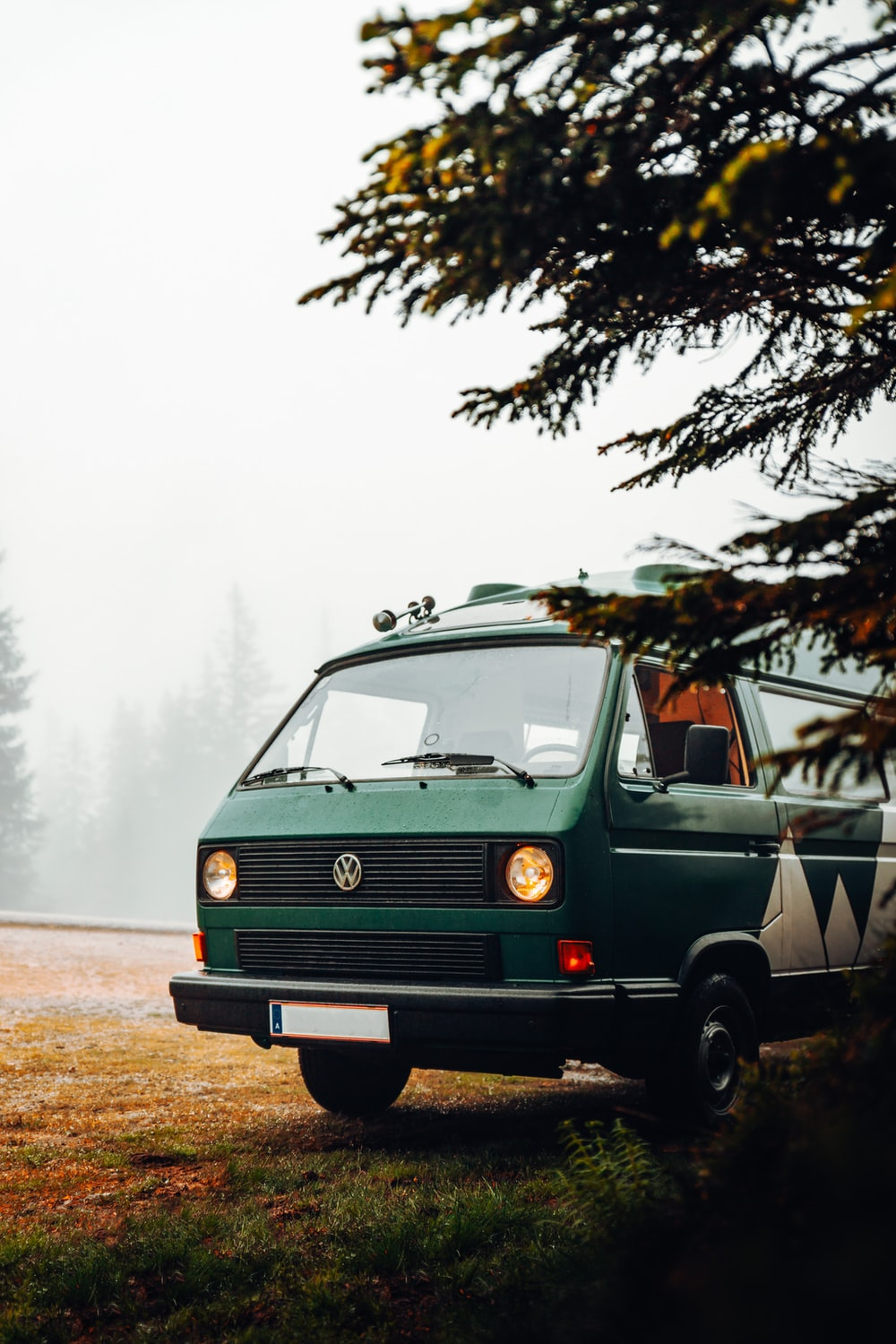 green volkswagen t-2 on road during daytime