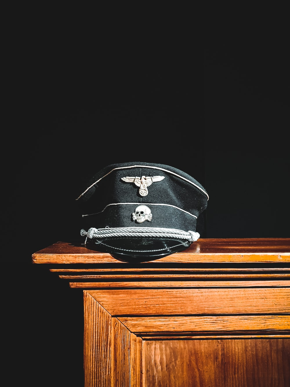 black and white helmet on brown wooden table
