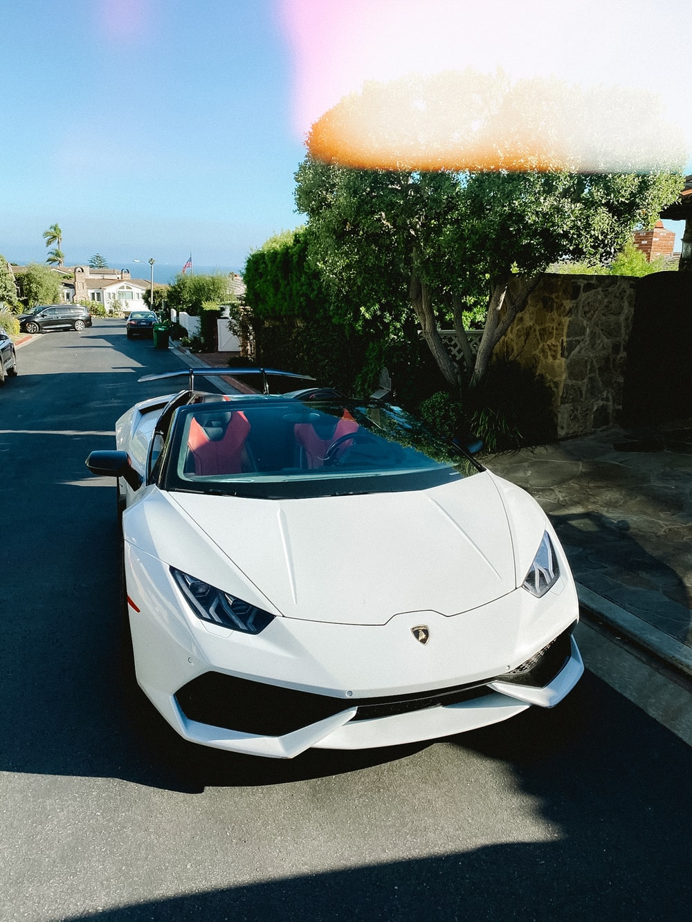 white lamborghini aventador parked on parking lot during daytime