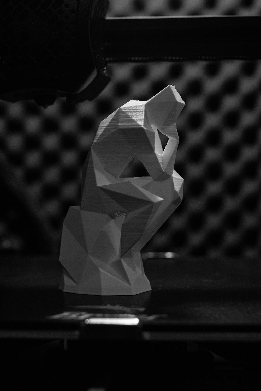 white and gray diamond on black surface
