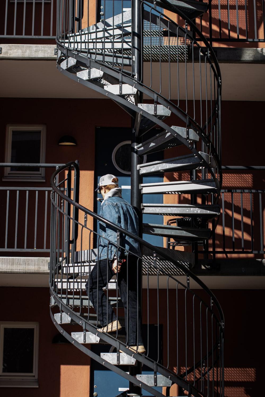 black spiral staircase with black steel railings