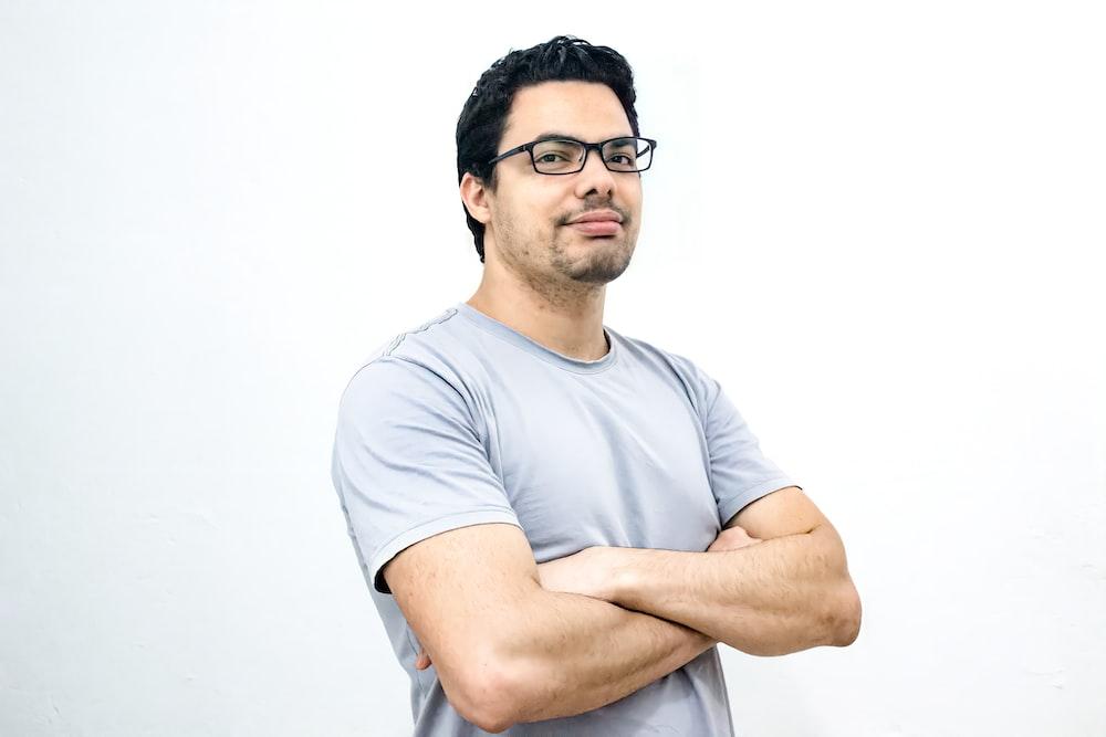 man in white crew neck t-shirt wearing black framed eyeglasses