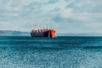 red ship on sea under white clouds during daytime commencement zoom background