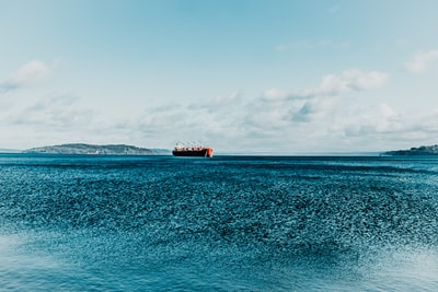 brown ship on blue sea under blue sky during daytime commencement zoom background