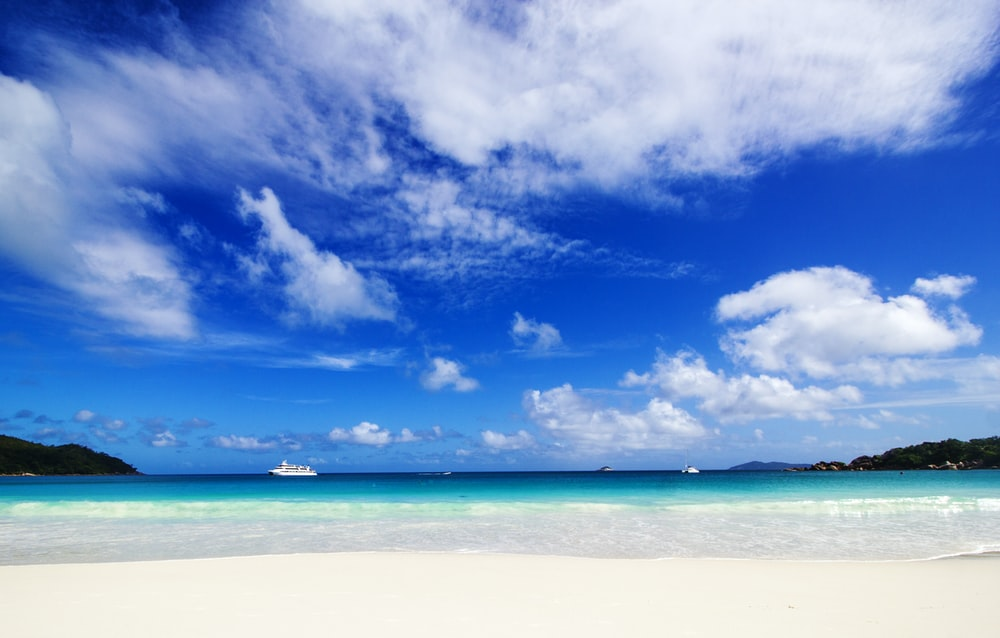 blue sky and white clouds over the sea