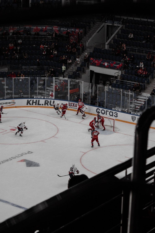 people playing ice hockey on ice stadium