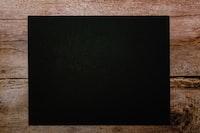 black flat screen tv on brown textile
