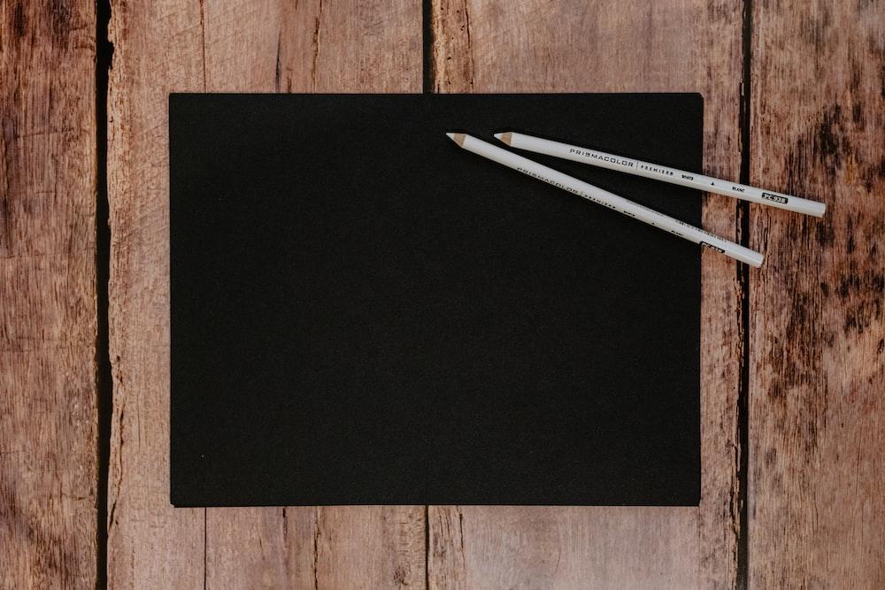 white sticks on black textile