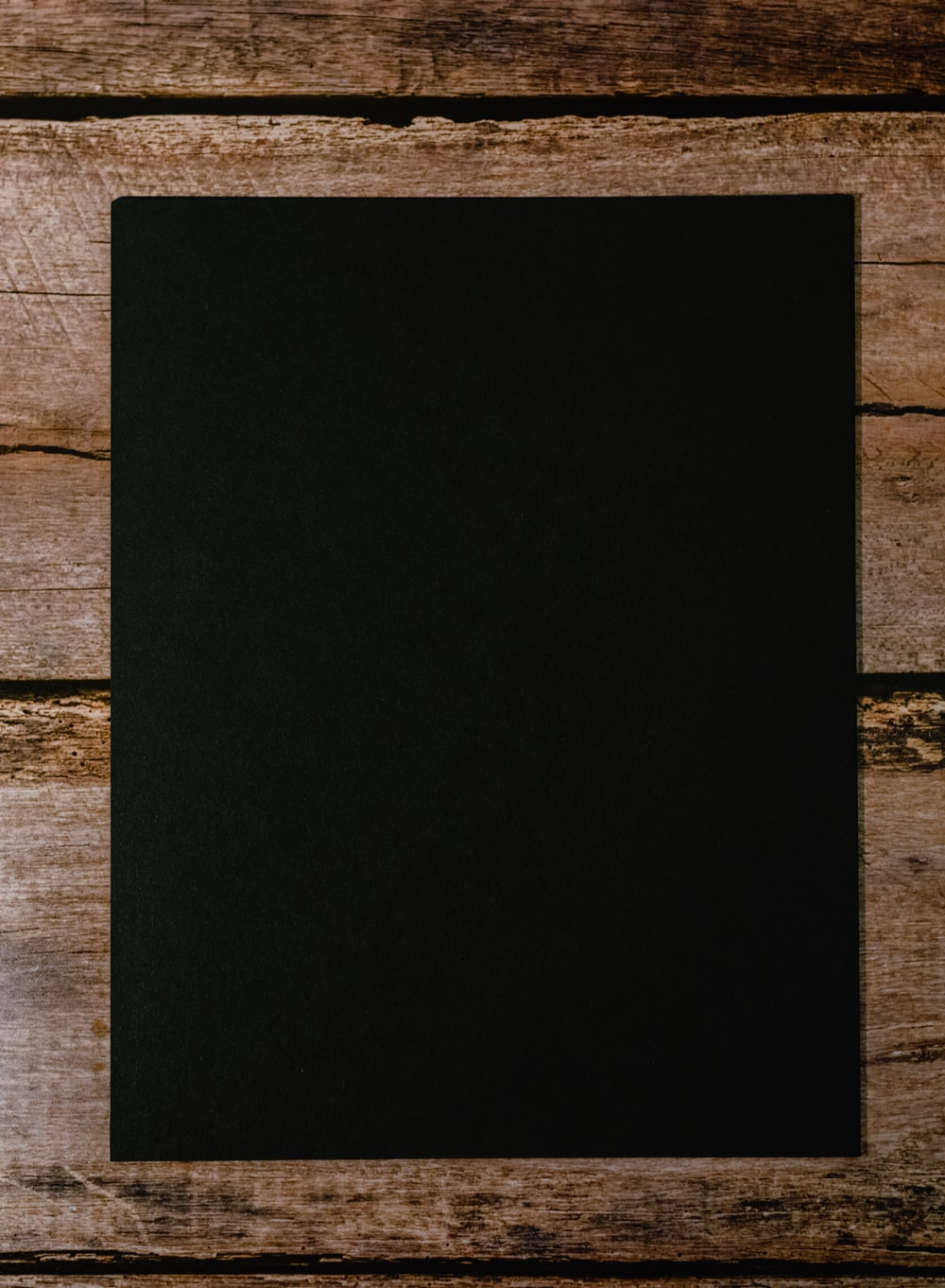 black paper on brown wooden table