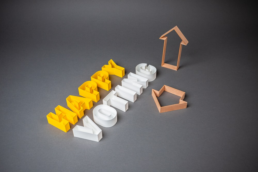 white plastic blocks on gray surface