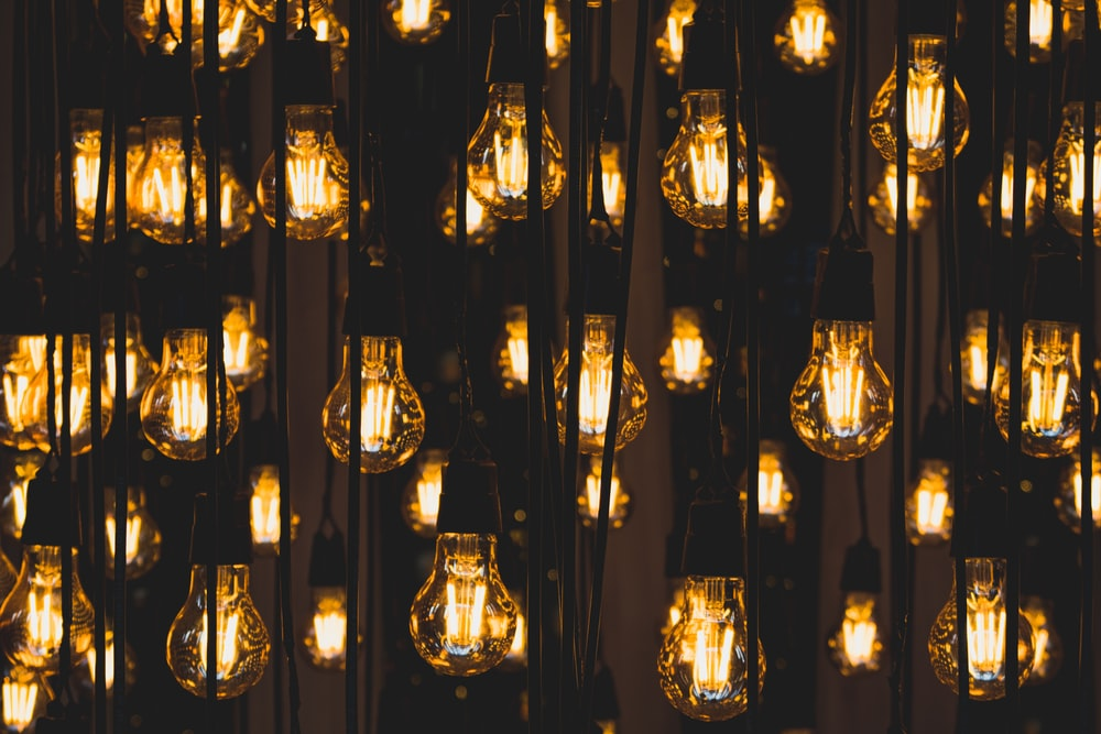 clear glass pendant lamps turned on during night time