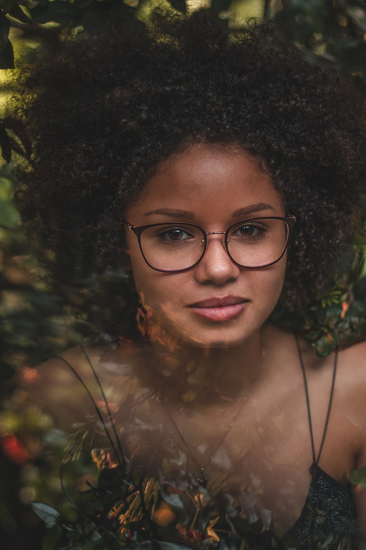 woman in black framed eyeglasses smiling